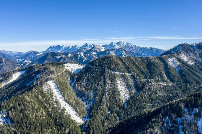 Austria, Carinthia, Aerial view of forested mountain range — Stock Photo