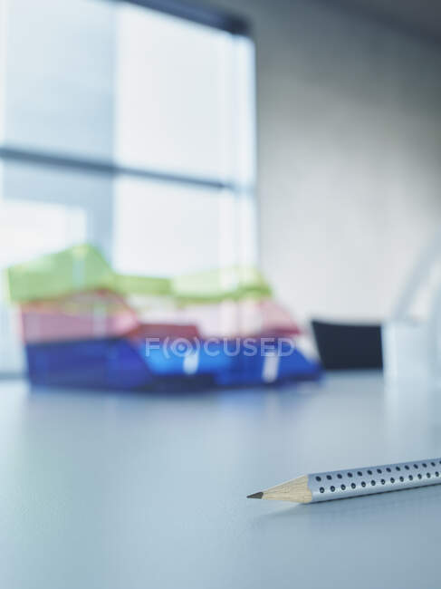 Close up of a pencil and a pen on a white background — Stock Photo
