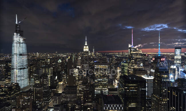 USA, New York,Aerial view of New York city skyscrapers with Empire State Building at night — Stock Photo