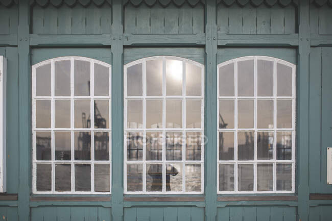 Germany, Hamburg, Ovelgonne, Port on river Elbe reflected in window — Stock Photo