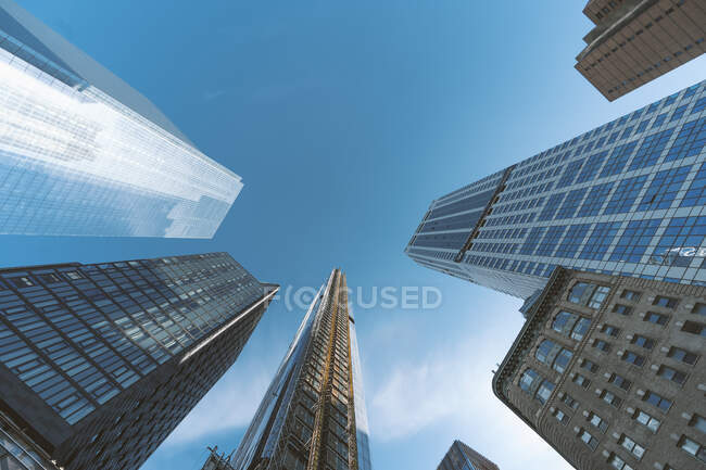 USA, New York, New York City, Directly below view of clear sky over Manhattan skyscrapers — Stock Photo