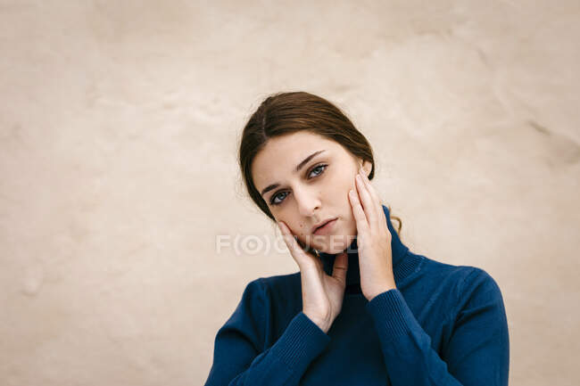 Close up portrait of woman with blue turtleneck pullover — Stock Photo