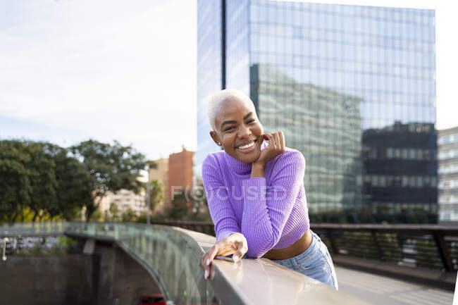 Portrait of mature white haired woman on a bridge in the city — Stock Photo