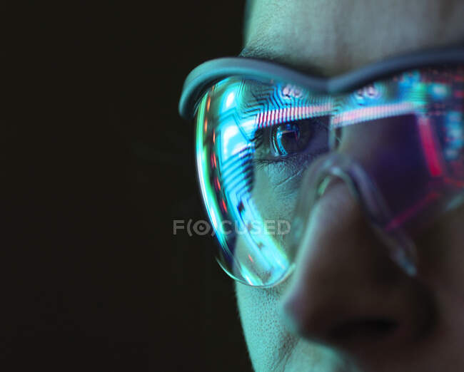 Reflection of a circuit board on glasses — Stock Photo