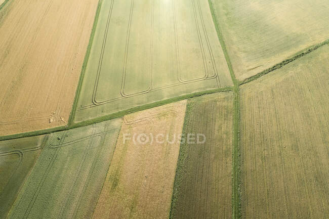 Germany, Bavaria, Franconia, Aerial view of green and yellow fields and dirt roads — Stock Photo
