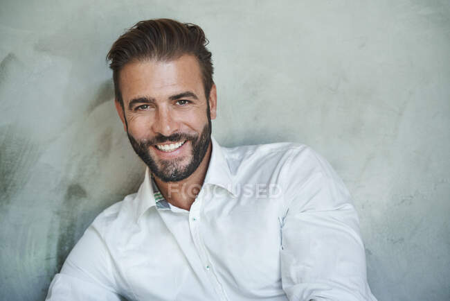 Portrait of happy businessman wearing white shirt — Stock Photo