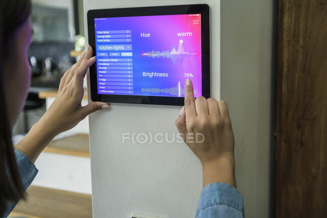 Young woman with tablet with smart home control functions — Stock Photo