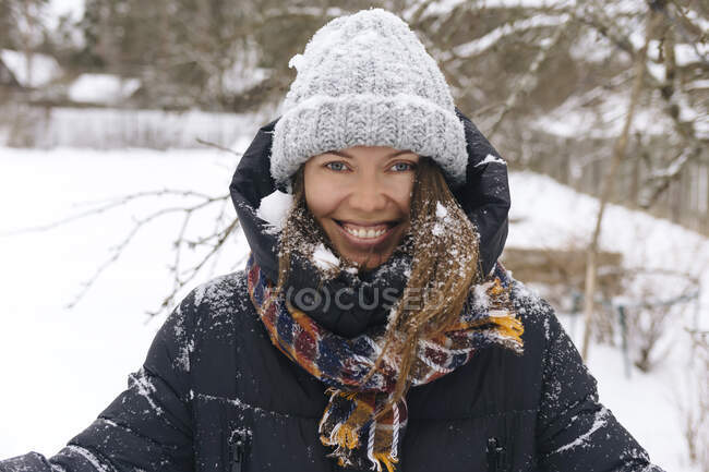 Portrait of woman enjoying snowfall — Stock Photo
