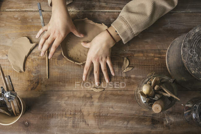 Close-up of potter working on wooden table — Stock Photo