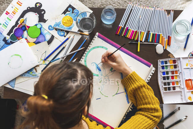 Woman painting with watercolours, top view — Stock Photo