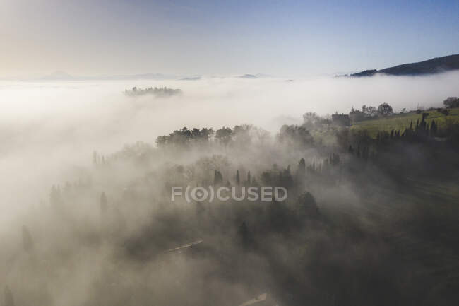 Italy, near Perugia, Aerial view of fog in valley — Stock Photo