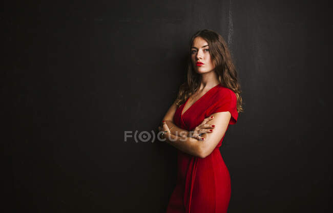 Portrait of young woman wearing red dress — Stock Photo