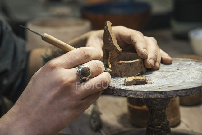 Close-up of potter working on workpiece — Stock Photo