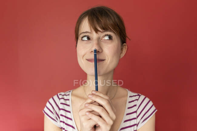 Portrait of smiling woman with — Stock Photo