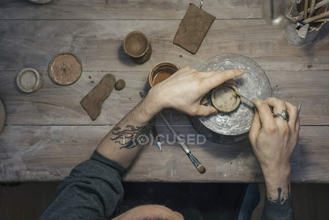 Top view of potter working on workpiece — Stock Photo