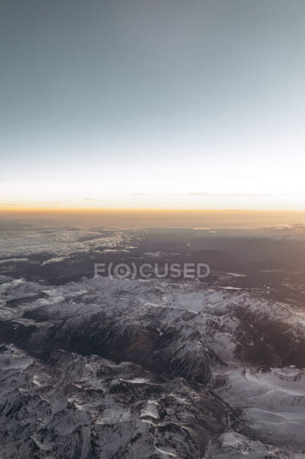 Finland, Aircraft view of snowcapped mountains at sunrise — Stock Photo