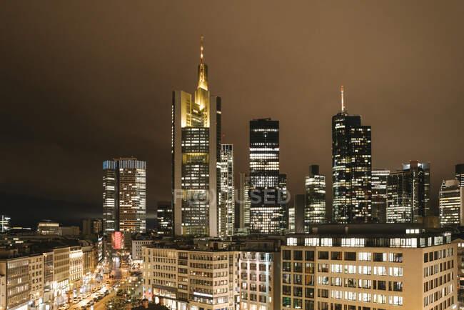 Germany, Hesse, Frankfurt, Illuminated city downtown at night — стокове фото