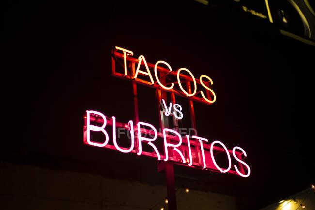 USA, New York City, Illumintated advertising for Tacos and Burritos — Stock Photo