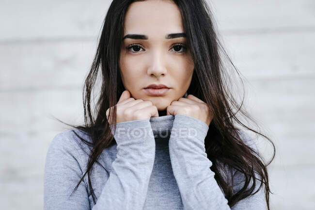 Portrait of young woman with black hair — Stock Photo