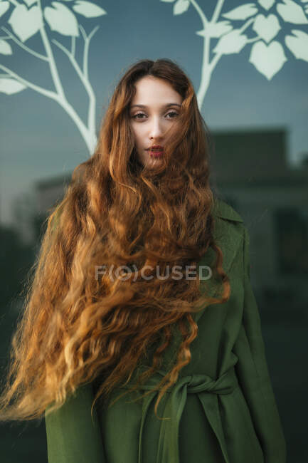 Portrait of redheaded young woman with blowing hair — Stock Photo