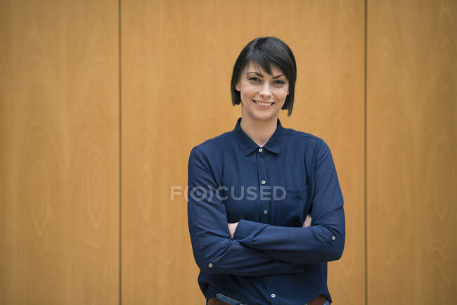 Portrait of smiling businesswoman, with arms crossed — Stock Photo