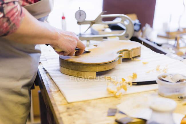 Female violin maker at work — Stock Photo