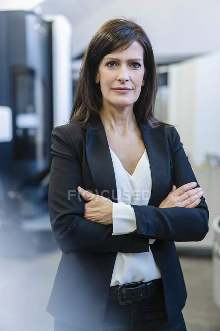 Portrait of a confident businesswoman in a factory — Stock Photo