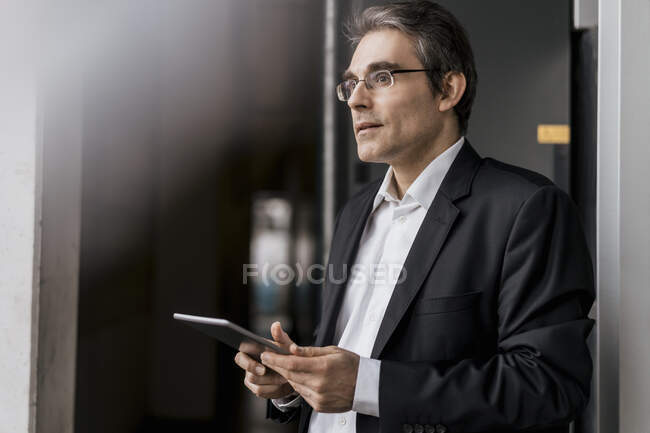 Mature businessman holding tablet in a factory — Stock Photo