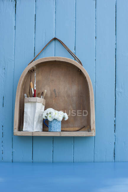 Shelf made from old wooden chair and brush holder made from milk carton — Stock Photo