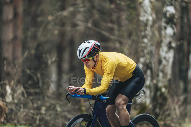 Young man in sports clothing riding bicycle — Stock Photo
