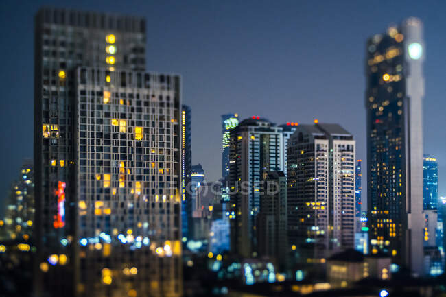 Thailand, Bangkok, Tilt shift of downtown skyscrapers at night — Stock Photo