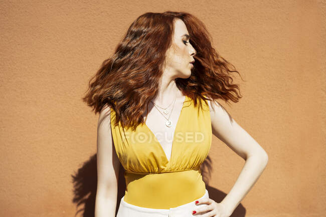 Redheaded woman moving her head — Stock Photo