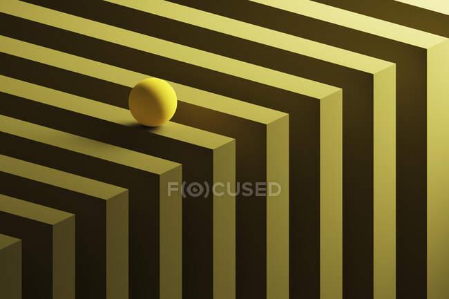 Rendimiento tridimensional de la pequeña esfera amarilla rodando sobre el patrón geométrico - foto de stock