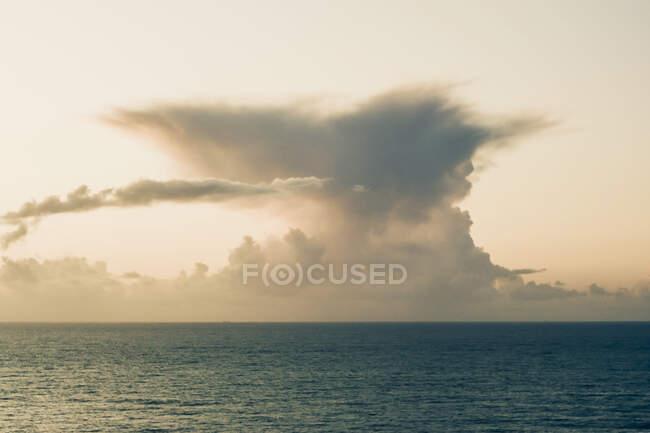 Sea cape at Ursa Beach against cloudy sky, Lisboa Region, Portugal — стоковое фото