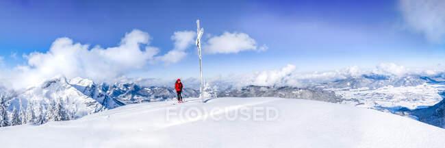 Senior man during ski tour at summit cross, Inzell, Kienberg, Germany — Stock Photo