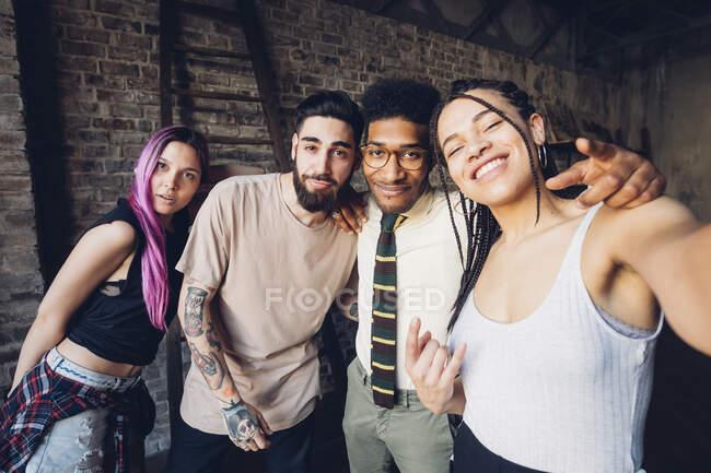 Selfie portrait of happy diverse friends — Stock Photo