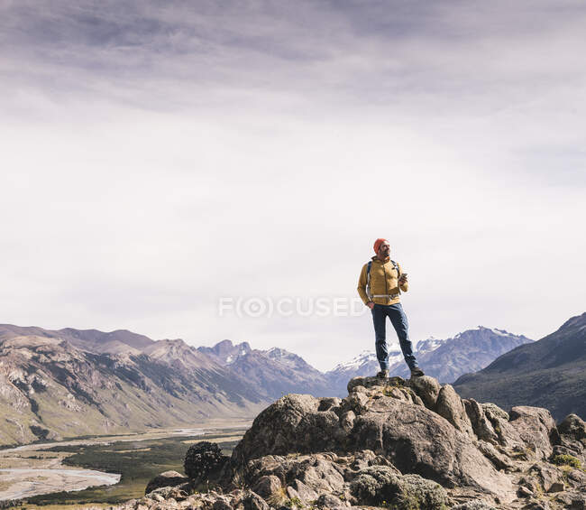 Mature male hiker standing on rock against sky at Patagonia, Argentina — Stock Photo
