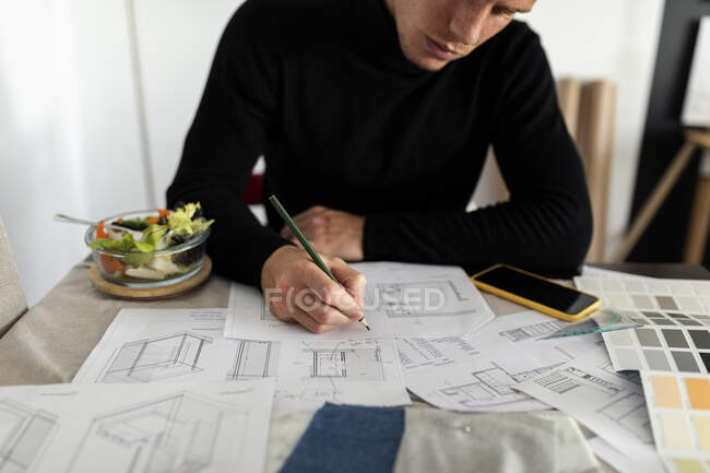 Male architect working on sketch at home office — Stock Photo