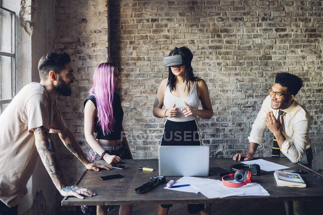 Creative team using Vr goggles in loft office — Stock Photo