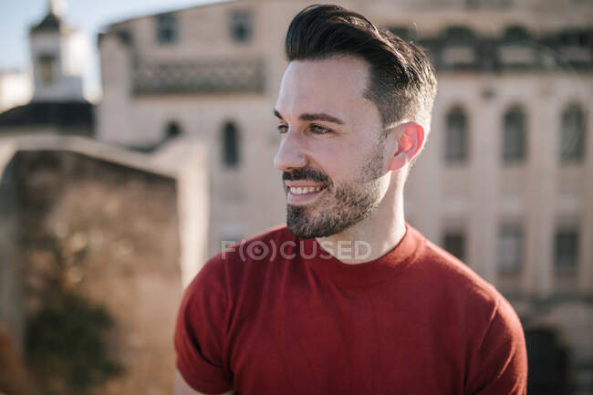 Close-up of smiling young man looking away — Stock Photo