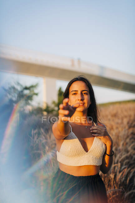 Woman standing against dry grass outdoors — Stock Photo