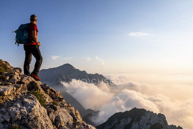 Man admiring view while standing on mountain peak at Bergamasque Alps, Italy — Stock Photo