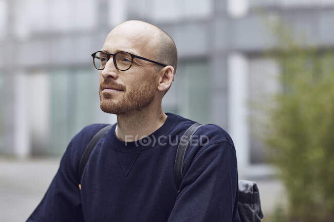 Mid adult man looking away while standing outdoors — Stock Photo