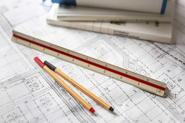 Pen and ruler on blueprint — Stock Photo