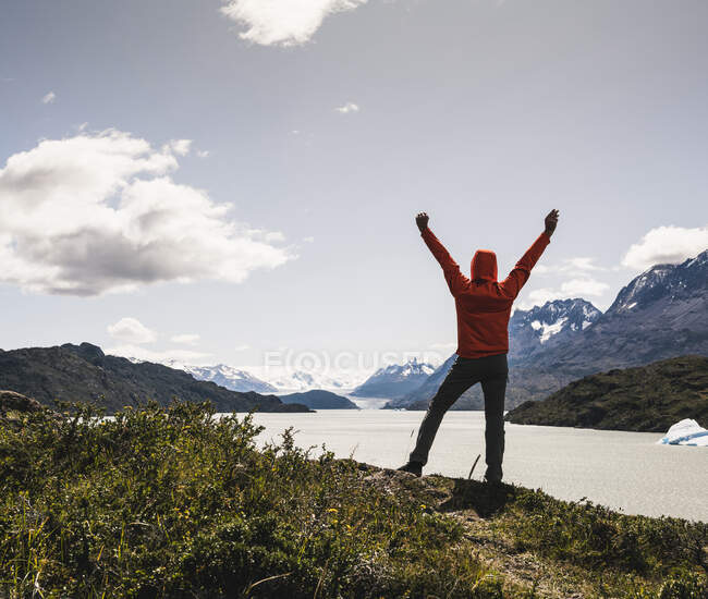 Man standing with arms outstretched during hiking at Torres Del Paine National Park, Patagonia, Chile, South America — стокове фото