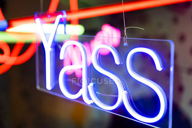 Blue neon sign glowing indoors — Stock Photo