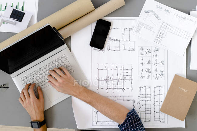 Architect working while sitting by desk at office — Stock Photo