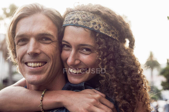 Close-up of couple embracing each other on street — Stock Photo
