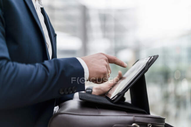 Close-up of entrepreneur using digital tablet in city — Stock Photo
