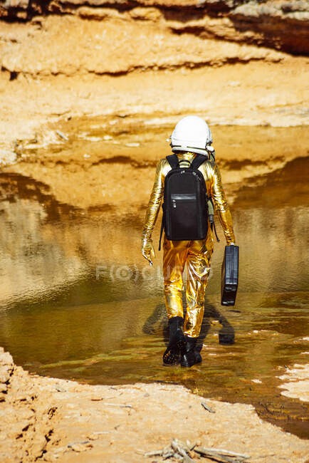 Astronaut standing while exploring on moon — Stock Photo